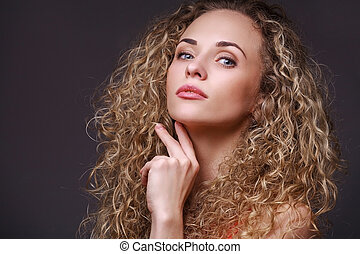 Woman in red shirt - Closeup portrait of woman with curly...
