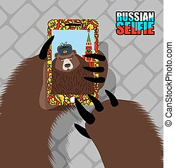 Russian bear selfie on red square Wild bear and tower of...