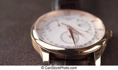 Luxury golden watch close up dolly shot