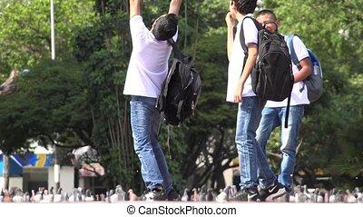 Teen Boys Having Fun At Park