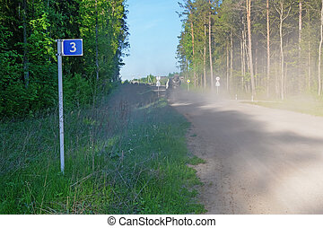 Earth road in spring forest - Left photo road sign - 3...