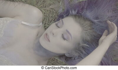 Closeup pretty woman in purple hair - Closeup of beautiful...