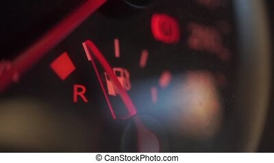 Car fuel gauge showing low fuel level clip