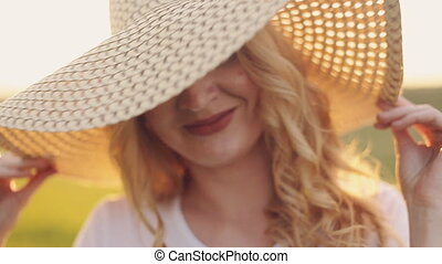 portrait of girl in straw hat at sunset - girl in straw hat...