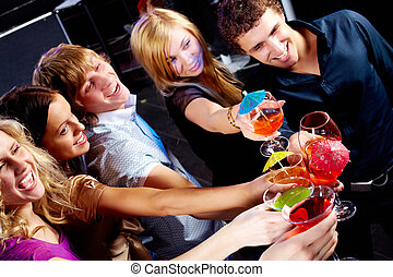 Toasting - Above angle of group of friends enjoying...