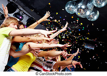 Clubbing - Photo of emotional teenagers stretching arms...