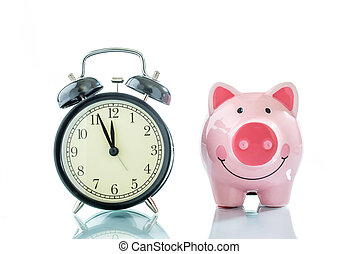 Alarmclock with piggybank on white background
