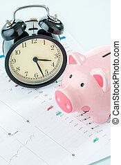 Alarmclock with piggybank, stock market - Alarmclock with...
