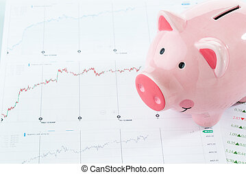 Piggy bank with stock data, investment concept