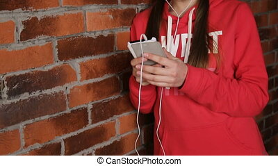 Girl with headphones listening music