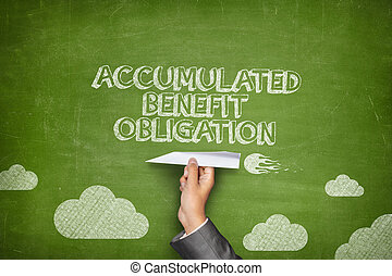Accumulated benefit obligation concept on blackboard with...