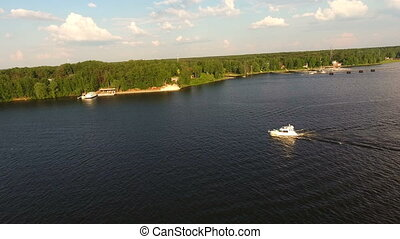 Aerial view:motor boat floats on the lake. - Fast motor boat...