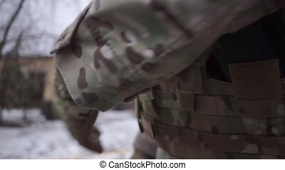 Soldier gets an automatic pistol out of the holster clip