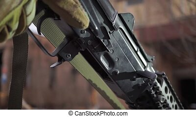 Attaching a magazine to Kalashnikov assault rifle. Close up...
