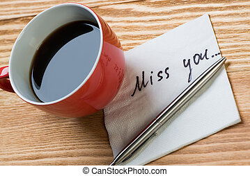 Romantic message written on napkin - Coffee cup pen and...