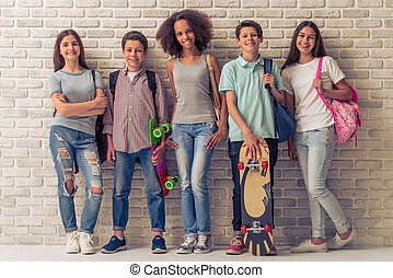 Happy teenage friends - Group of teenage boys and girls with...