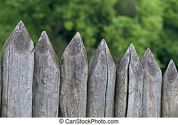 Fence stakes, a fence made of logs, tapered wooden stakes