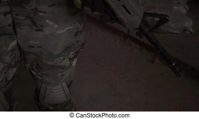 Soldier wearing camouflage holding an assault rifle Close up...