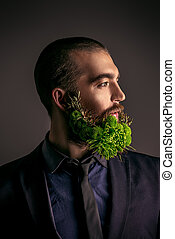 man in profile - Profile of a handsome man with a beard of...