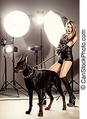 dog training - Attractive young woman in fitting leather...