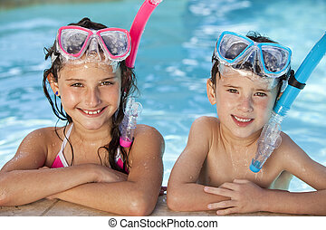 Boy and Girl In Swimming Pool with Goggles and Snorkel -...