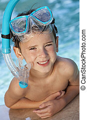 Happy Boy In A Swimming Pool with Goggles and Snorkel