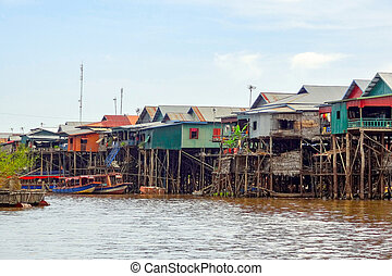 traditional settlement at the Tonle Sap river - traditional...