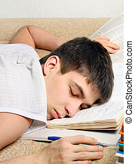 Teenager sleep on the Books - Tired Teenager sleep on the...