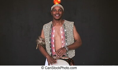 Handsome African Man Playing Drum and smile