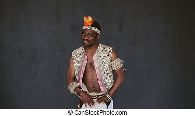 African Man Playing Drum and smile