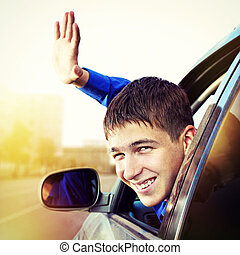 Teenager in the Car - Toned Photo of Cheerful Young Man sit...