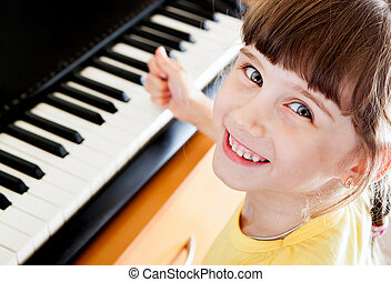 Small Girl with Piano - Happy Small Girl with the Piano...