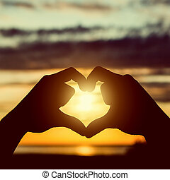 Hands in Heart Shape - Toned Photo of the Hands in Heart...