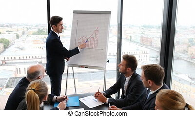 Business people at presentation - Business people analyzing...