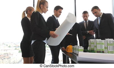 Architects and investors with model - Business meeting of...