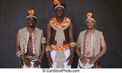 Three African mans smiles broadly
