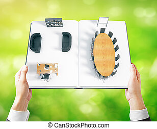 Businessman holding book with interior