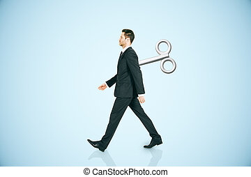 Walking man with wind-up key - Walking businessman with a...