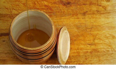 footage barrel of honey on a wooden table close-up. HD video