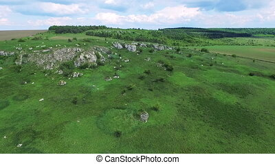 Aerial view of green rocks, hills, trees in full HD
