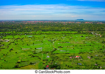 Aerial view of Siem Reap city and green fields, Cambodia