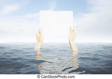 Hands in water holding board - Hands in water holding blank...