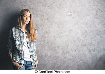 Beautiful woman against concrete wall - Casually dressed,...