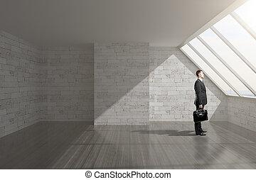 Man in empty interior - Businessman holding briefcase in...