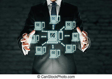 Businessman holding abstract computer network