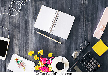 Messy office desktop with notepad - Top view of creative...
