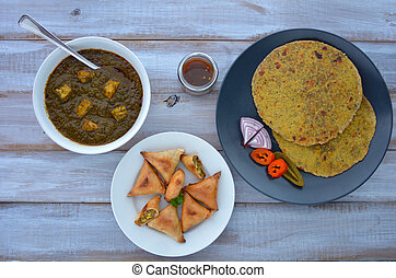 Flat lay of Paratha flatbread Indian cuisine served with...