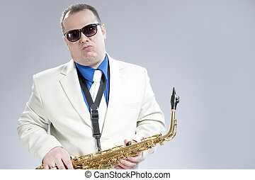 Expressive Funny Male Saxo Player in White Suit and...
