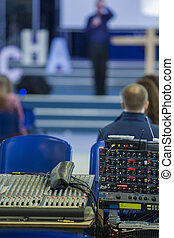 Closeup of Professional Mixing Console During Conference...