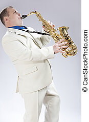 Music Concepts Natural Portrait of Expressive Male Saxophone...